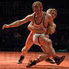 Tribune Star/ Rachel Keyese<br /> Fight It Out: Terre Haute South's P.J. Montgomery puts up a hard fight against Crown Point's Jason Tsirtisis in the State Championship match Saturday night at Conseco Fieldhouse.