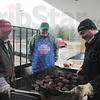 Tribune-Star/Rachel Keyes<br /> Cooking It Up: West Vigo Chemistry teacher Bob Jackson (left) along with Randy Easton (middle) and assistant girls basketball coach Mike Buske cook up some steak for the Alumni dinner held before the boy's game Saturday night.