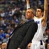 Tribune-Star/Jim Avelis<br /> Body English: Indiana State University head basketball coach Greg Lansing urges the ball into the basket while Jake Odum calls the shot on a Jordan Printy three pointer.