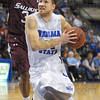 Tribune-Star/Jim Avelis<br /> Coming in: Aaron Carter finds a seam to the basket past Saluki defender Mykel Cleveland.