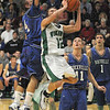 Tribune-Star/Rachel Keyes<br /> Airtime: West Vigo's Jordan Houser catches some big airtime as he drives the lane for two more against Rockville on Saturday.