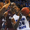 Tribune-Star/Jim Avelis<br /> Inside man: Myles Walker takes the ball inside against Southern Illinois defenders Davante Drinkard and Mykel Cleveland. Walker had 10 points and 9 rebounds for the Sycamores in their regular season finale.