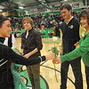 Tribune-Star/Rachel Keyes<br /> Honoring The Queen: 2011 Homecoming Queen Kaitlyn Tilford (left) hands a rose to Ella Blackburn Homecoming Queen of 1963 (right) who is being escorted by her son Brad Joy (middle).