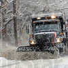 Plowing: A Terre Haute City Street Department snow plow removes snow along US 40 near Blakely Avenue Saturday afternoon. Following behind is a second plow removing the overflow snow.