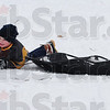 Tribune-Star/Rachel Keyes<br /> Wipe Out: Eight-year-old Jimmy Popoff wipes out trying to climb the hill at Deming Park. The mix of snow and ice made a treacherous playground for local adventurers.