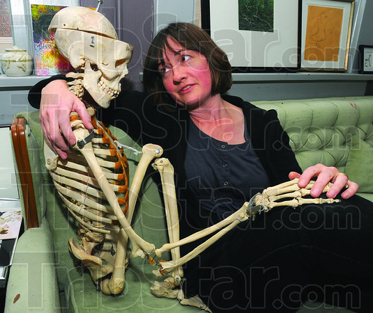 """Me & Fred: Nancy Nichols-Pethick keeps """"Fred"""" in her Fairbaks Hall office. The skeleton, or parts thereof, has been used as a prop in different works of art by both her and her ISU students."""