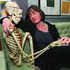 "Me & Fred: Nancy Nichols-Pethick keeps ""Fred"" in her Fairbaks Hall office. The skeleton, or parts thereof, has been used as a prop in different works of art by both her and her ISU students."