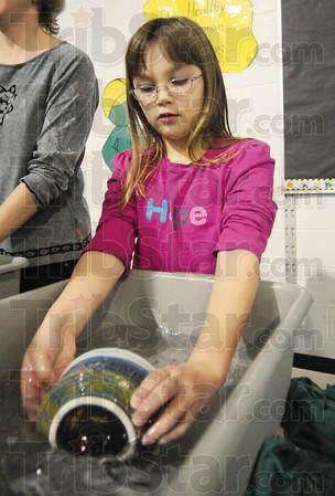 Tribune-Star/Rachel Keyes<br /> Good Help: Catholic Charities found some good help in seven-year-old Daisy Troop 2163 volunteer Katie Grieb.