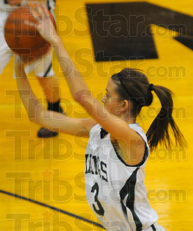 Tribune-Star/Jim Avelis<br /> Hot hand: Cassidy Carlson shoots in first half action agaisnt Owen valley in their sectional matchup Wednesday night.