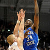 Steve Jahnke / The Southern<br /> Indiana State's Myles Walker shoots over SIU's Carlton Fay Wednesday, Feb. 16, 2011 at the SIU Arena.