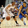 Steve Jahnke / The Southern<br /> Indiana State's Dwayne Latham attempts to steal the ball from SIU's Diamond Taylor Wednesday, Feb. 16, 2011 at the SIU Arena.