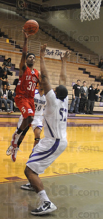 Tribune-Star/Jim Avelis<br /> First two: Jermaine Smith scores the first two points of the Braves' game against Ben Davis on the Giants home floor Wednesday night.