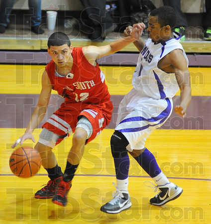 Tribune-Star/Jim Avelis<br /> Making room: Anthony McGill tries to create a little space to work agaisnt Ben Davis defender Kendall Broome