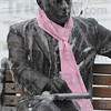 Tribune-Star/Jim Avelis<br /> Sit placidly: A thoughtful has has made a token effort to keep the bronze of Max Ehrmann at 7th and Wabash streets comfortable during the recent cold snap.
