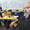 Radio room: Doug Mullens mans the radio system at the Vigo County Emergency Management headquarters Wednesday morning.