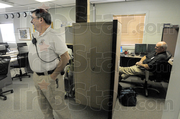 Calmed: J.D. Kesler (L) and deputy director of operations Keith Holbert take a moment to relax after spending much of Tuesday monitoring the storm situation from the Emergency Management office at Hulman Field.