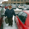Tribune-Star/Jim Avelis<br /> A little easier: Nancy Lovett, a patient care tech at Regional Hospital, walks gingerly over the icy parking lot to her car after being driven there in a hospital courtesy van.