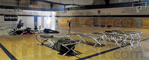 Safe and warm: Children play in the North High School auxillary gym Wednesday morning because of a power outage. Several people took advantage of the shelter to keep warm.
