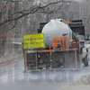 Salt spray: A Vigo County Highway Department vehicle puts a salt brine onto the roadway near Mill Dam Monday afternoon.