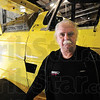 Tribune-Star/Rachel Keyes<br /> Proud Papa: Owner of Turbine Inc. Jim Mills stands next to a newly rebuilt plane that is ready for pick up.