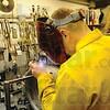 Tribune-Star/Rachel Keyes<br /> Sparks Fly: Welder Kevin Kauffman solders engine parts for work on a turbine engine.
