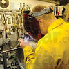 Tribune-Star/Rachel Keyes<br /> Sparks Fly: Welder Kevin Kauffman solders engine parts for work on a turbine engine.