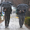 "Tribune-Star/Jim Avelis<br /> Double Whammy: The song says ""Rainy days and Mondays always get me down"".  Here ISU faculty members Paul Schikora and Ken Jones return to the College of Business after their lunch break. Day long rain Monday swelled the Wabash River , pushing it over the 14 foot flood stage."