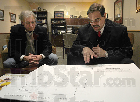 Tribune-Star/Rachel Keyes<br /> Well Laid Plans: Chairman of the 2010 Annual Fundraising Campaign John Dinkel (left) and Executive Director of the Union Hospital Foundation James Bertoli go over plan for renovating the Labor and Deliver department of Union Hospital West.