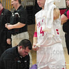 Tribune-Star/Rachel Keyes<br /> Clean It Up: Terre Haute South Brave's Lucas Steward get the blood cleaned off his jersey by Athletic Trainer Scott Kidder after a run in with Vincennes Lincoln's Avory Mickens.