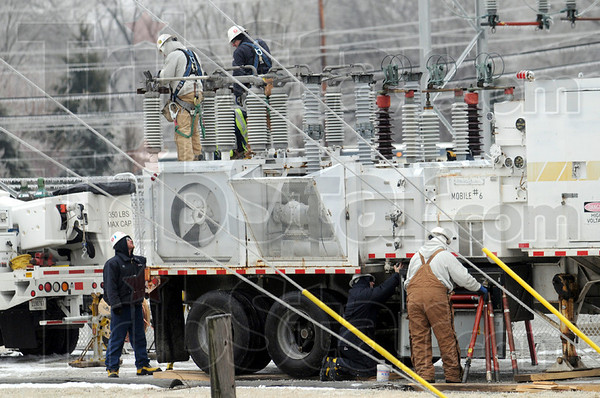Temporary fix: Duke Energy crews work Tuesday morning to put a temporary substation into place until they can repair the substation located near Concannon Elementary School and return service to West Terre Haute customers.