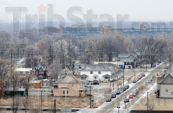 Tribune-Star/Jim Avelis<br /> Ice out: Ice laden tree sand vacant city streets is the scene from the Indiana State University School of Business tower Tuesday afternoon.