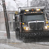 Scrape: A Terre Haute Street Department truck with a snowblade scrapes ice from Lafayette Avenue near McLean High School Tuesday afternoon.