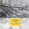 Downed: A downed tree limb blocks south 9th Street near Hulman Tuesday morning.