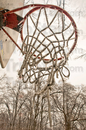 Tribune-Star/Rachel Keyes<br /> Iced out: A layer of ice from Monday night freezing rain coats a basketball net.