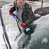 Tribune-Star/Jim Avelis<br /> Common scene: Malina Baker chips icer from the windshield of a friend's car  in downtown Terre Haute Tuesday afternoon.