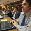 Tribune-Star/Jim Avelis<br /> On duty: Indiana representatives from the Wabash Valley Bob Heaton, left, and Bruce Borders, right, listen to House leader Brian Bosma at the beginning of the day's work Tuesday.