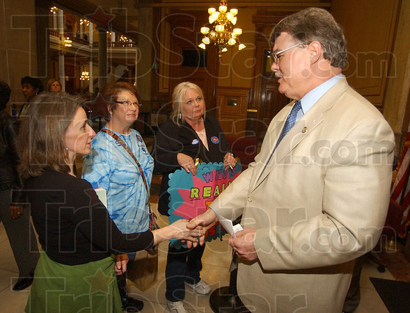 Tribune-Star/Jim Avelis<br /> Listening: Indiana state senator Tim Skinner of Terre Haute talks with teachers Tisa Cunningham, Susan Poehl and Karon Jaynes outside the Senate chambers Tuesday afternoon. Skinner had just finished commenting on legislation that could affect the three in their jobs. Cunningham and Poehl are from Michigan City and Jaynes is from the Union township school district near Valparaiso.