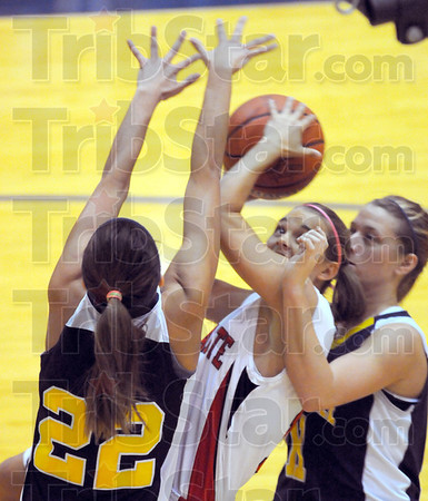 Tribune-Star/Jim Avelis<br /> Contact sport: Haley Seibert gets in close for a shot with Pioneers Jama Sharp(22) and Mandy Fisher guarding her.