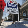 Foreclosure: Coldwell Banker agents Sharon Vanlandingham and Letitia Bennett install a foreclosure sign on a southside home Tuesday afternoon.