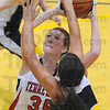 Tribune-Star/Jim Avelis<br /> Constant pressure: Terre Haute South center Hannah Lee tries to get off a shot past the defense of Pioneer Jama Sharp.