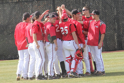 The GWU Baseball team huddles before the game.