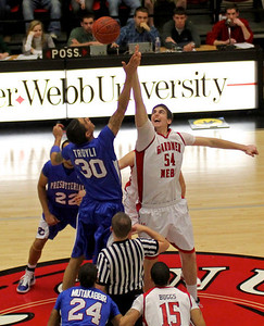 Jon Moore (35) attempts to steal the ball from a member of the Presbyterian team.