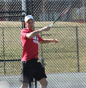 Adam Knutsson-Sundblad plays in a doubles match against the Trojans of Anderson.