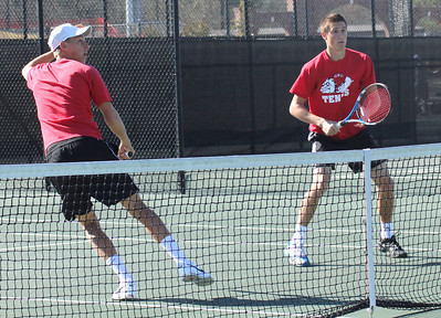 Adam Knutsson-Sunblad (L) and Julien Belair (R) play in a doubles' match on February 19th.