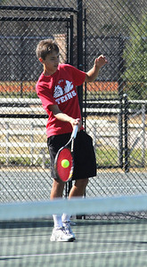 Roman Piftor awaits his doubles match against the Anderson Trojans.