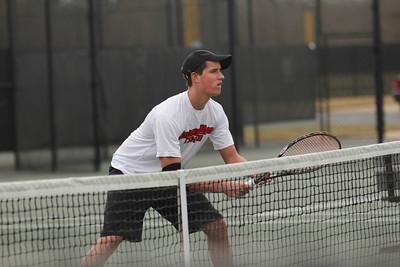 Matthew Parker awaits a serve from the opposing team.
