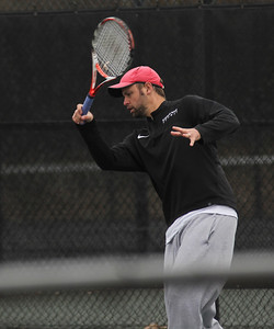 Senior Andrew Veeder practices before his match against Presbyterian College.