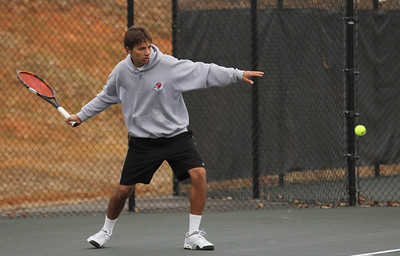 Roman Piftor practices beofre his match against the Blue Hose of Presbyterian College.