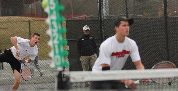 Julian Belair (L) and Matthew Parker (R) play in a doubles match against Presbyterian.