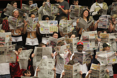 Students at Gardner-Webb react to the starting lineup of the Winthrop Men's Basketball team.